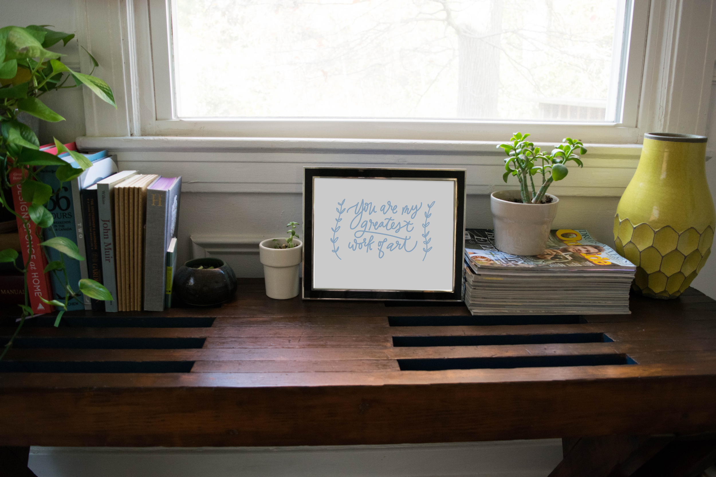 "Holly's piece ""You are my greatest"" letter press print is on the bench"