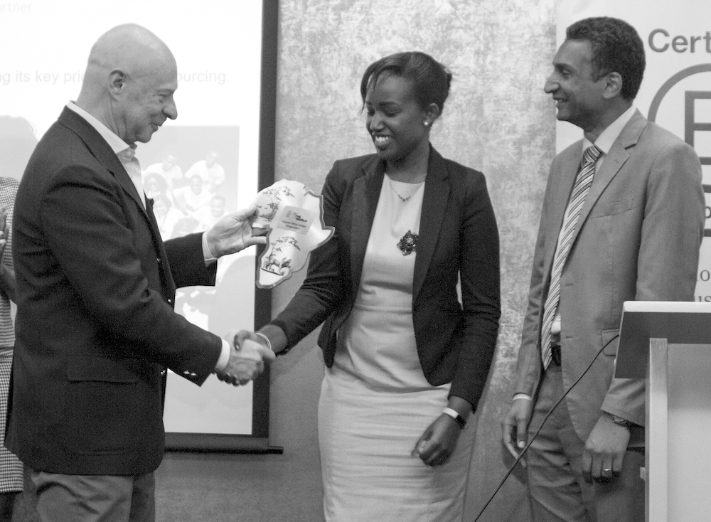 BEST FOR THE WORLD. Caroline Wanjiku, CEO of Daproim Africa, accepts the Best for the World award from Global B Corp ambassador Marcello Palazzi at a B Corp event in Kenya.