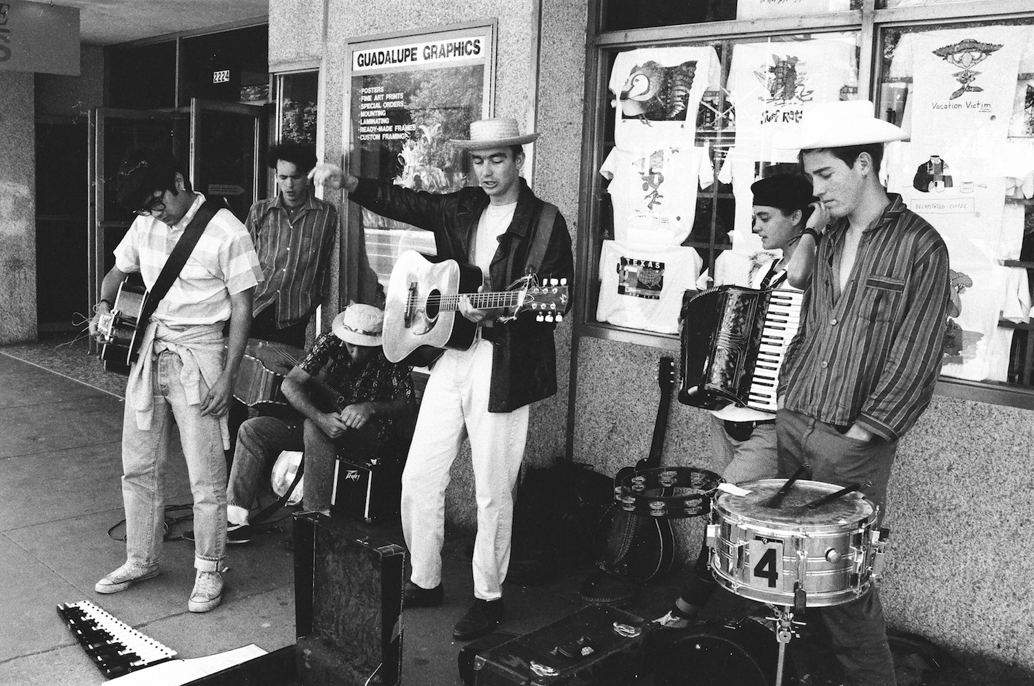 Poi Dog Pondering playing on the Street in Austin TX., 1986/ Cliff, Jared, Alan, Frank Orrall, Abra Moore, Sean Coffey /Photo by Jean Francois Berneron