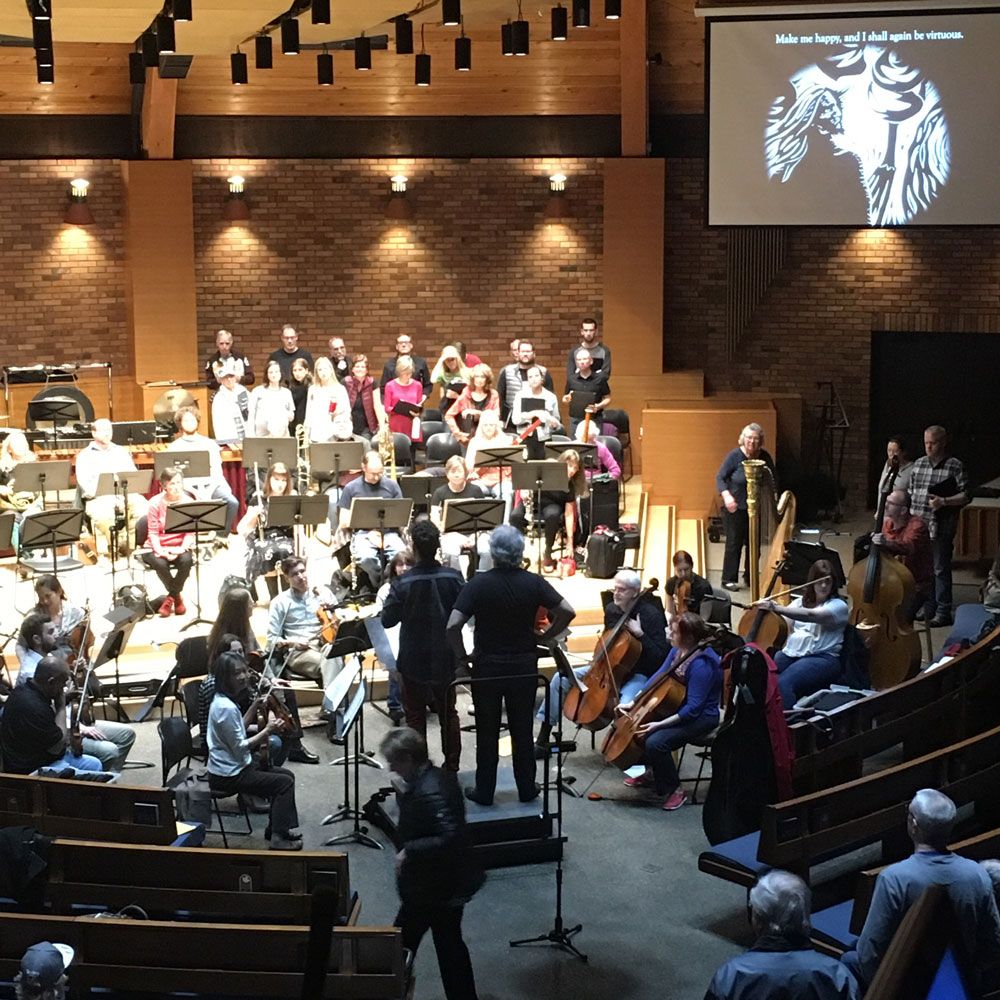 Duncan and Yaki Bergman in rehearsal with the orchestra and choir