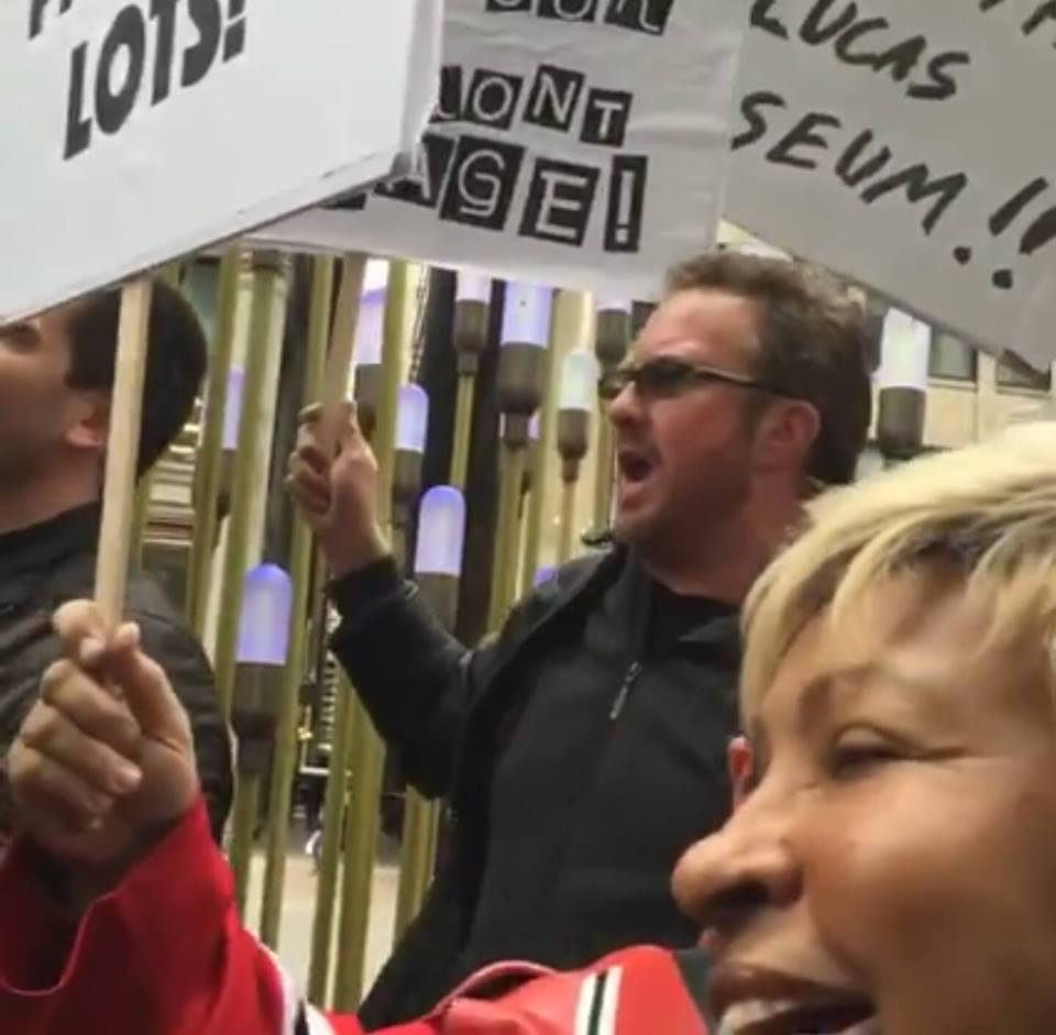 Jimmy Mac stands with the protesters outside the Friends of the Parks HQ in downtown Chicago to Save The Lucas Museum