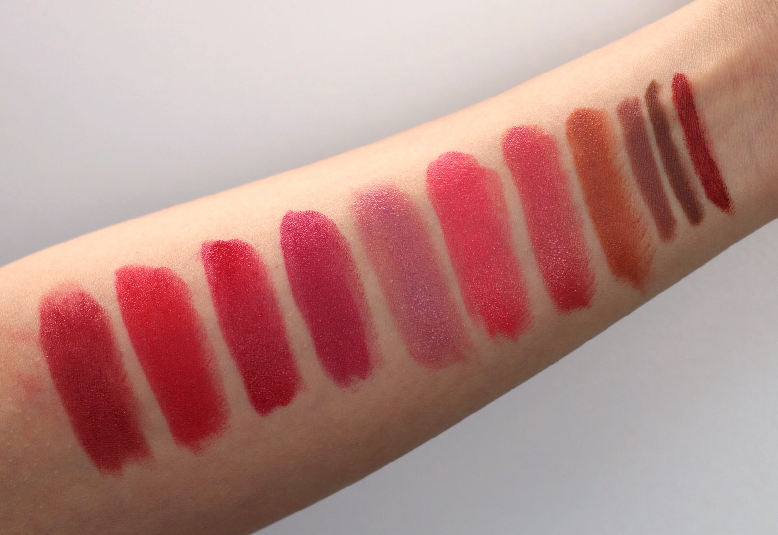 (L-R) VAPOUR:COURAGE,REAL PURITY: CLOVER RED,SANTE:NO.23,REAL PURITY: DEWBERRY,VAPOUR: PURR,REAL PURITY: ROSE,SANTE: NO.21,VMV HYPOALLERGENICS: GILDA,JANE IREDALE: SPICE,JANE IREDALE: NUDE,AND ZOSIMOS BOTANICALS: GARNET.