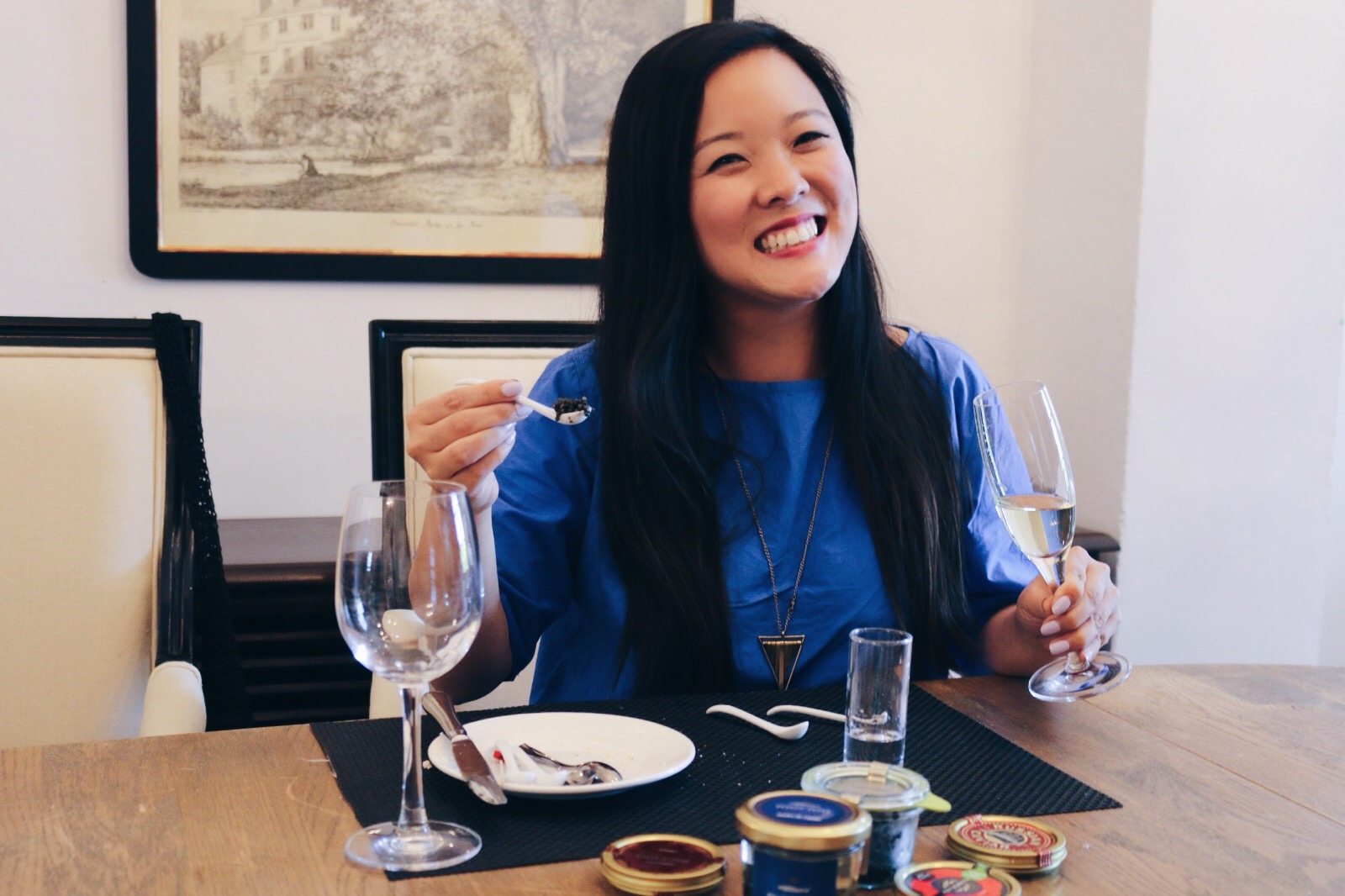 A SMILE THAT CAN ONLY BE BROUGHT ON BY TASTING ALL THE CAVIAR
