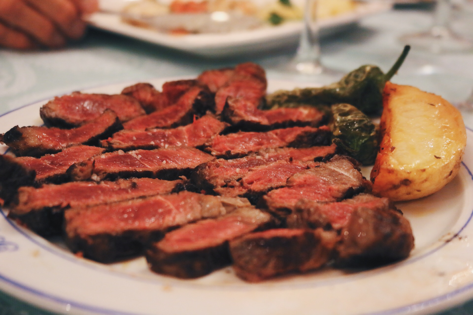 STEAK, POTATOES AND PIMIENTOS DE PADRON PEPPERS, FAMILY-STYLE