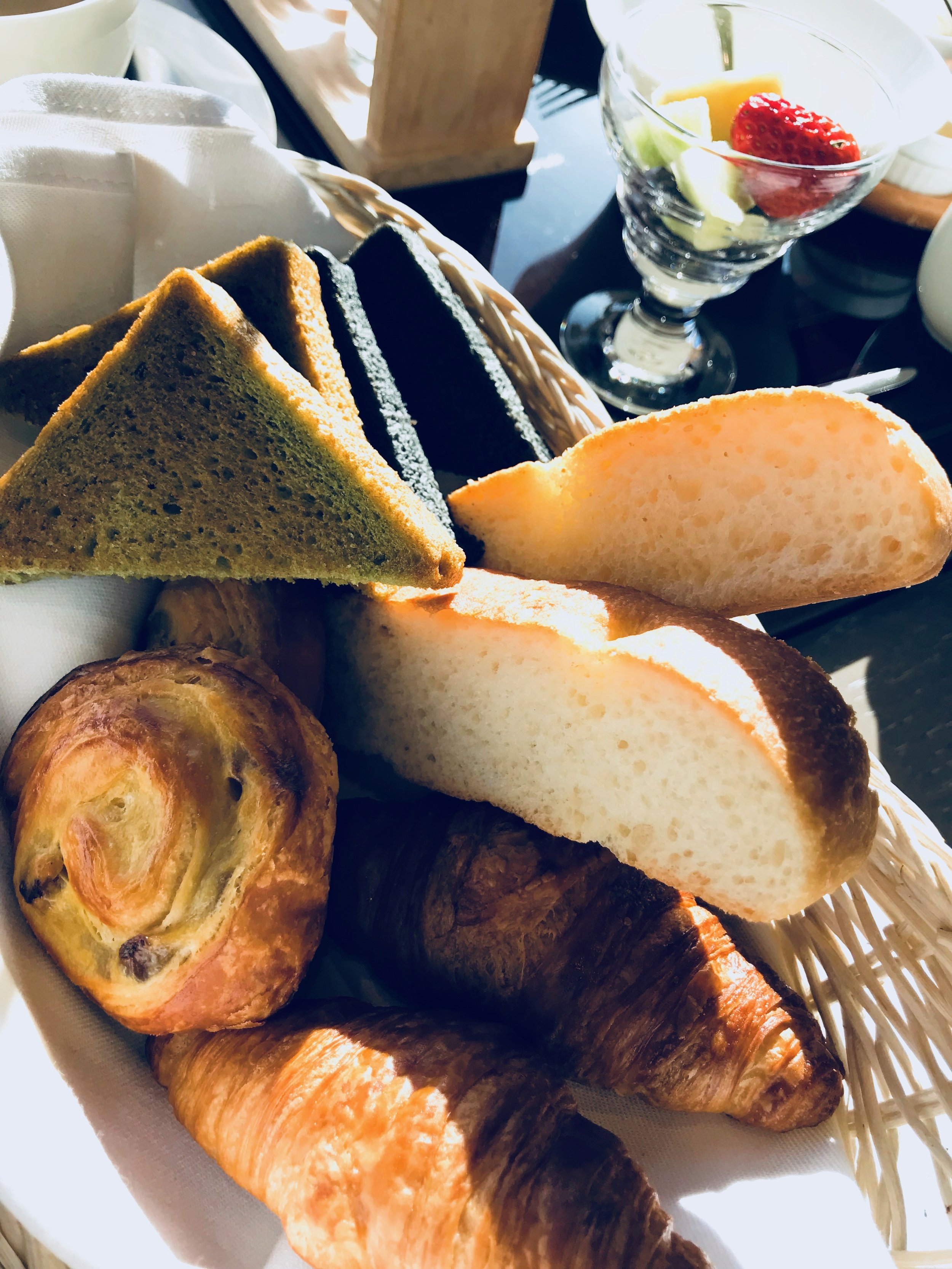 Matcha and squid ink toasts with various pastries and croissants