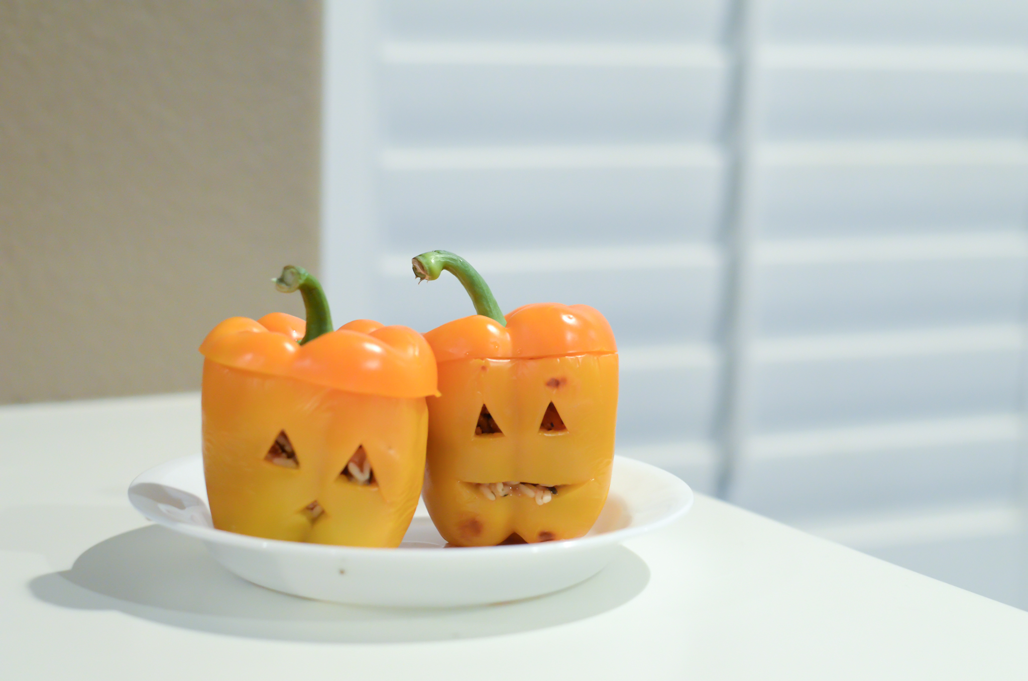 Directions: - 1. Heat oven to 375°F. Cut thin slice from stem end of each bell pepper to remove top. Remove seeds and membranes; rinse peppers. Reserve tops. If necessary, cut thin slice from bottom of peppers so they stand up straight. Using small sharp knife, cut out small eyes, nose and teeth from each pepper to look like jack-o'-lantern.2. Cook rice in microwave as directed on package. Meanwhile, in a 12-inch skillet, cook turkey and chopped vegetables over medium-high heat from 5-7 minutes, stirring occasionally until turkey is thoroughly cooked; drain. Stir in 1/2 cup of the tomato sauce, the ground turkey, and cooked rice.3. Stuff peppers with turkey mixture. Pour remaining tomato sauce in an ungreased 11x7-inch (2-quart) glass baking dish. Stand peppers upright in dish. Replace pepper tops.4. Cover tightly with foil. Bake 45 minutes. Uncover; bake about 15 minutes longer or until peppers are tender.