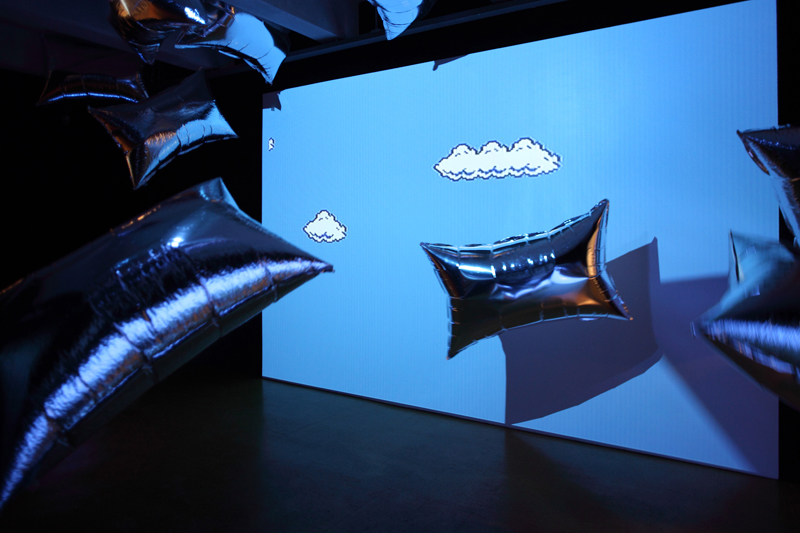 Andy Warhol's Silver Clouds with Cory Arcangel's Mario Clouds at the Warhol Museum in Pittsburgh. Image courtesy coryarcangel.com.