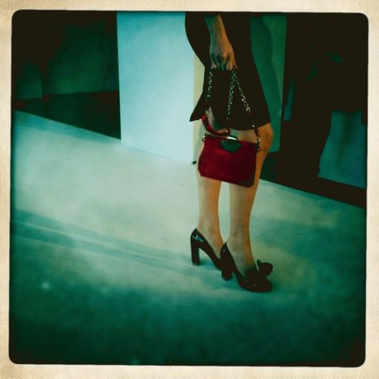 This is a true Ricci girl to me— slim silhouette in a fitted little pencil skirt. You don't always need to see the face to know who the woman is, and Peter gets this. A bag and a shoe, they don't match, but they could … it's unmistakingly Nina Ricci.