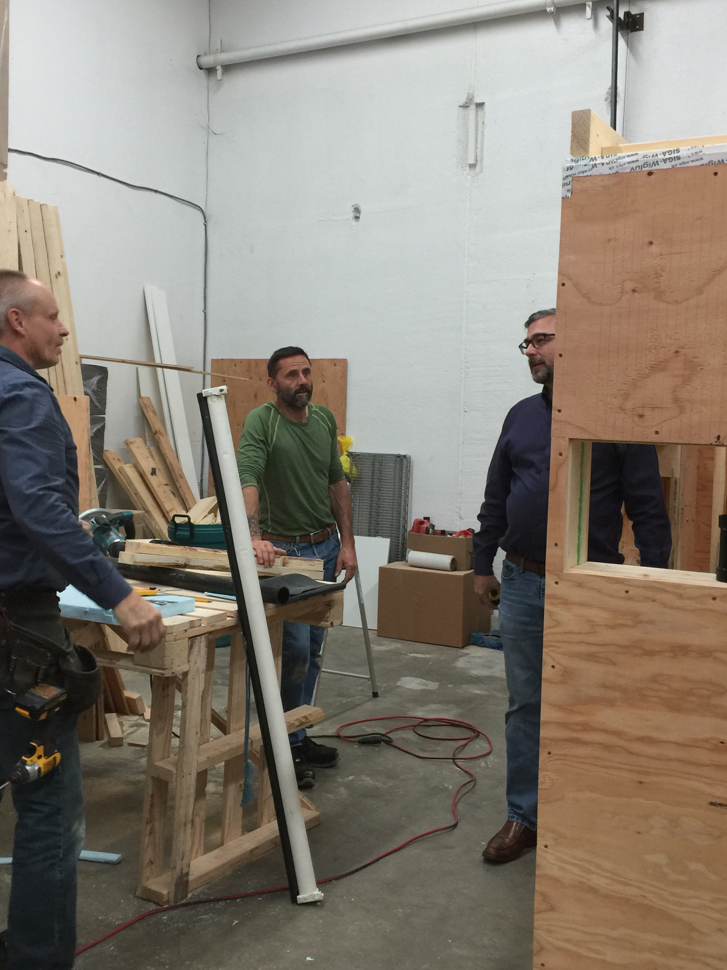 Albert Rooks, Geoffrey Kirkpatrick and Albert Rooks working on the modules in the Small Planet Supply Warehouse