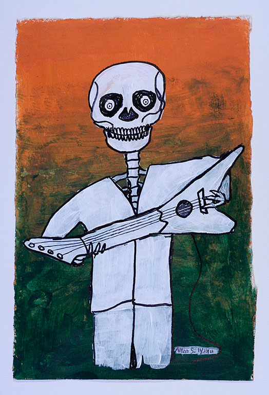 Alton-skeleton-w.-guitar.jpg