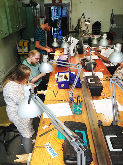 The gang making jewelry at the Steel Yard