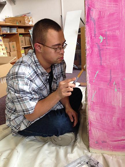 Juan painting furniture