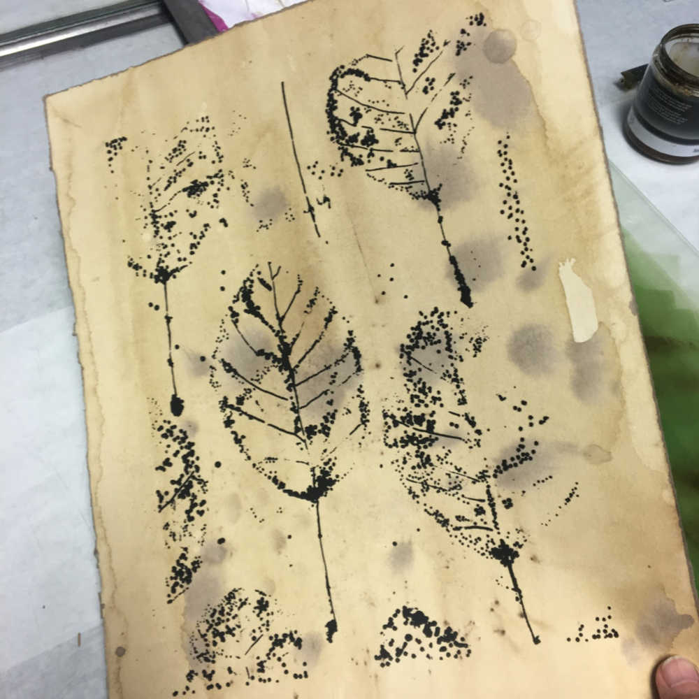 Screen-print leaves on stained paper