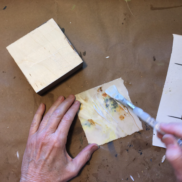 Apply Golden Matte Medium to board and back of paper artist Carol Ann Webster