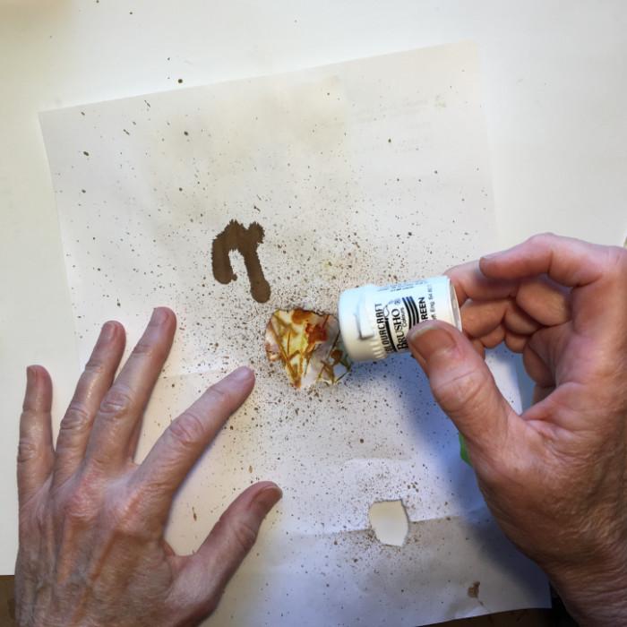 Sprinkle Brusho crystals through mask artist Carol Ann Webster