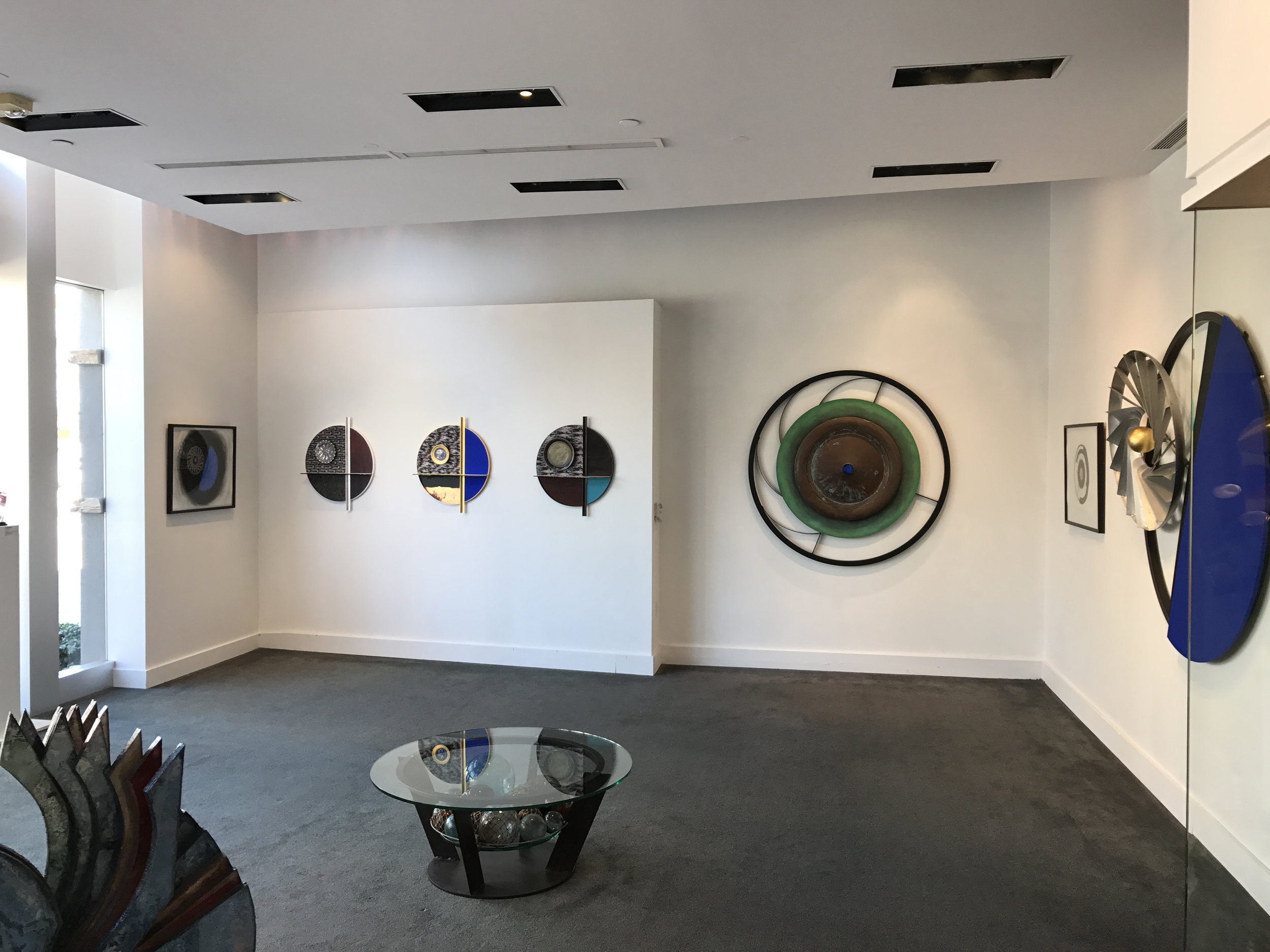 "Gallery View of ""Rings"" series by Michael Davis from a solo exhibition along with ""On Being Blue"" works by Jay McCafferty."