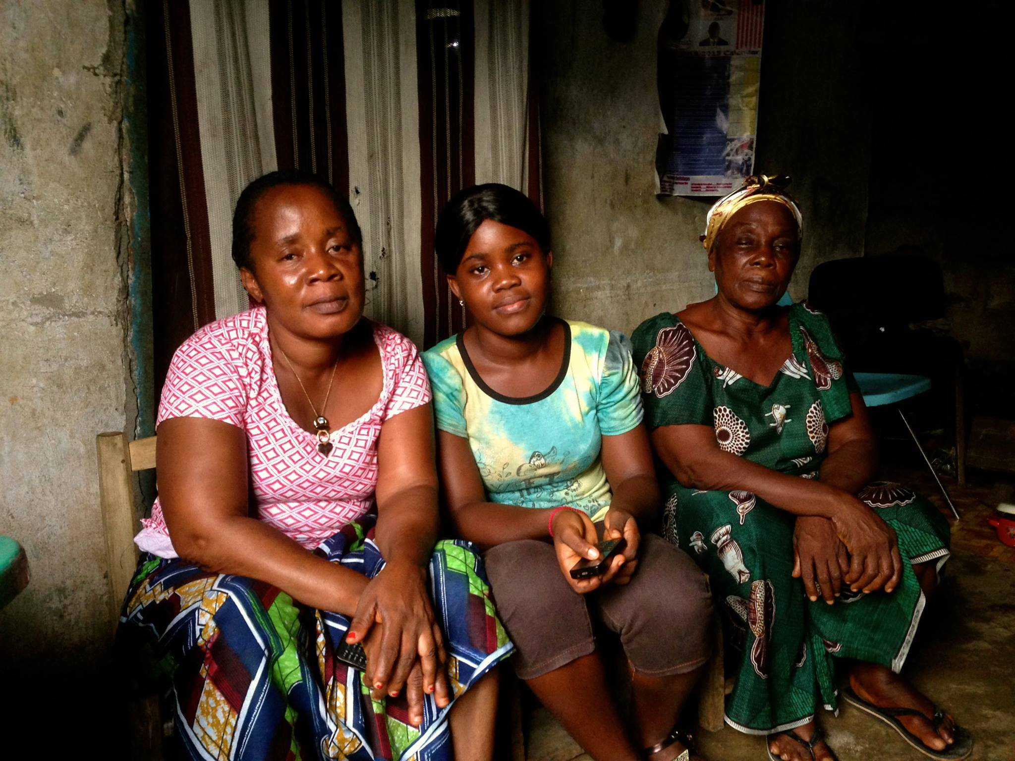 Three generations of strong Liberian women.  Philemina Joh, LEF scholar and aspiring accountant, with her mother Anna and her grandmother Esther.