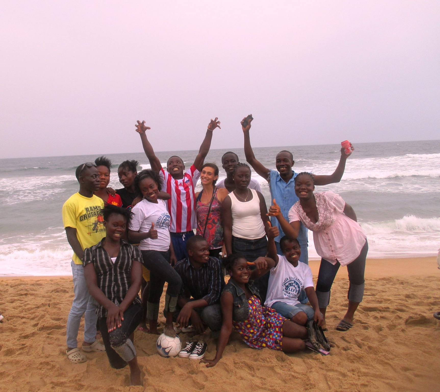 Monrovia students and Program Director, Kim celebrating Liberian Independence Day on the beach.