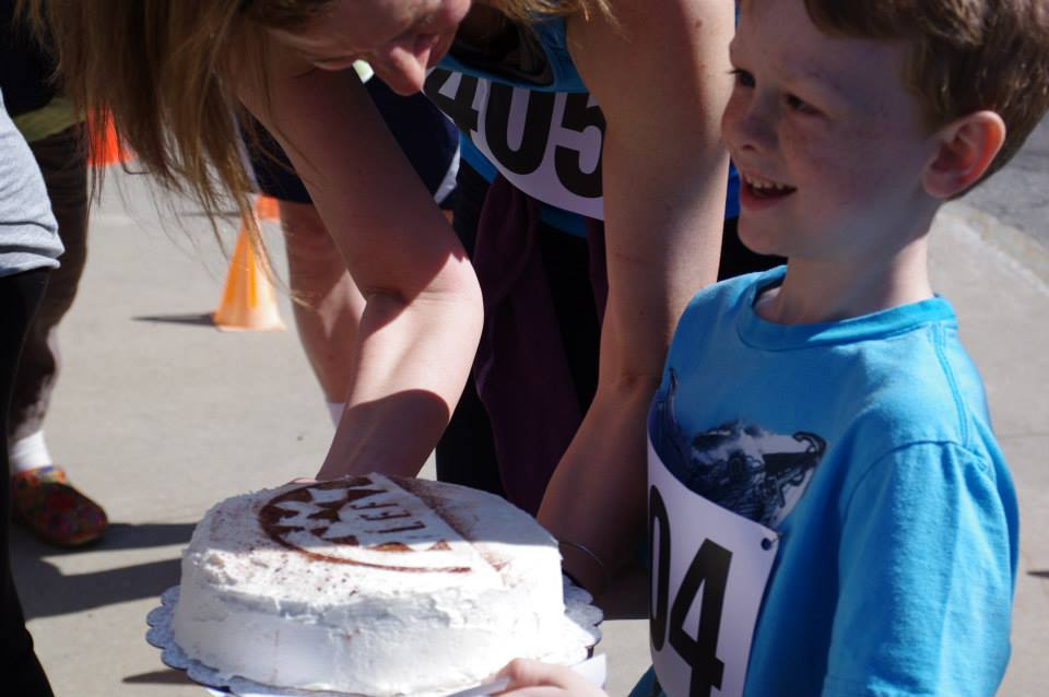 Winner and his prize at Watershed High School's annual 5k LEF fundraiser.