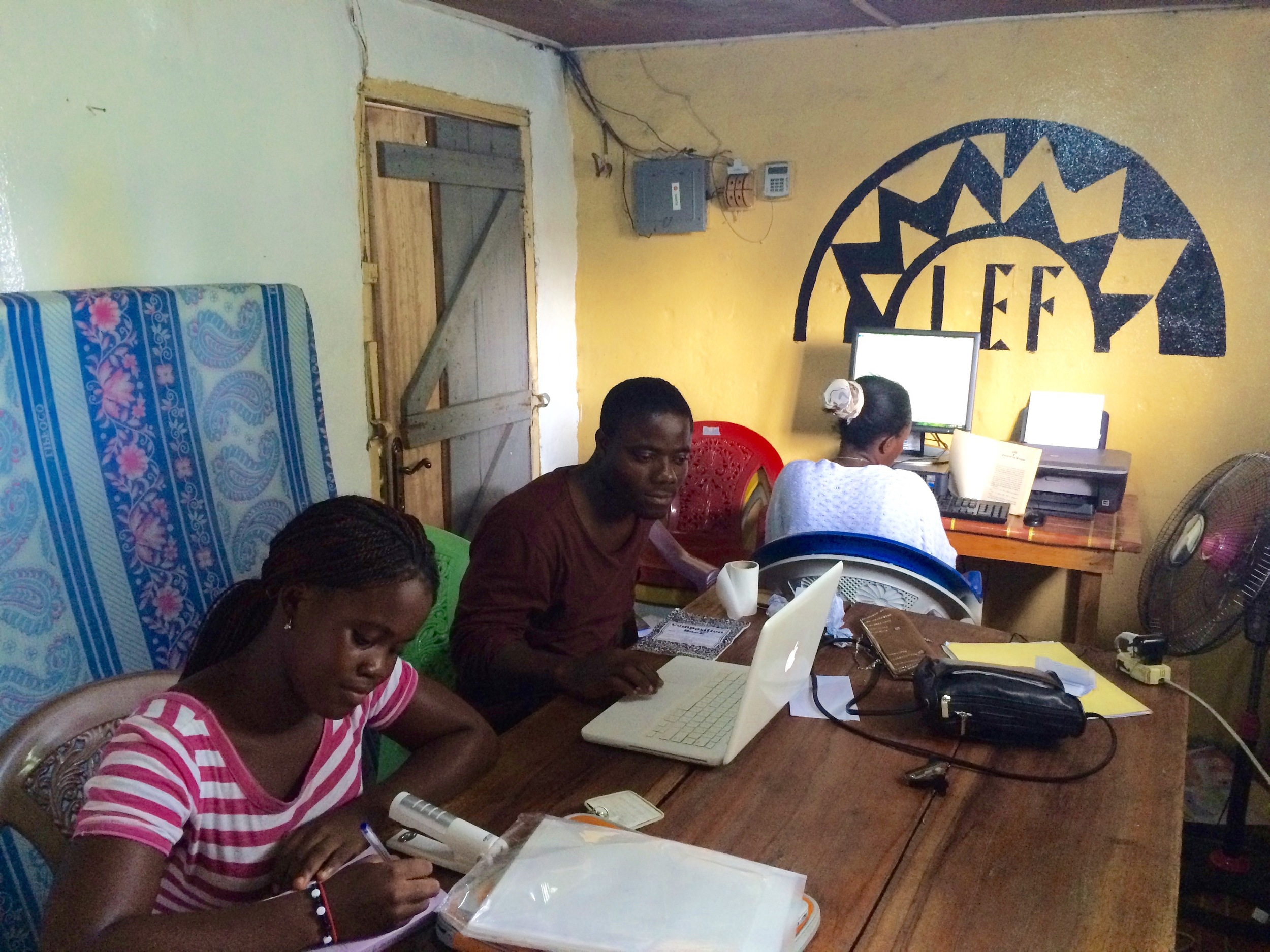 Coordinators and students using the LEF office in Liberia to work.