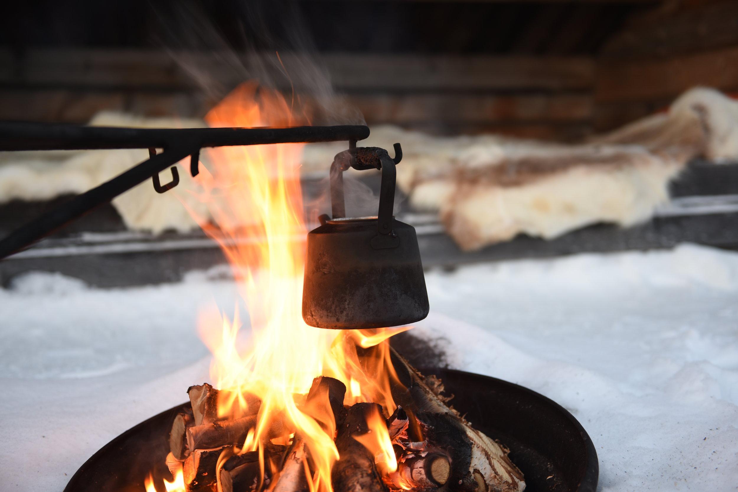 lunch by an open fire on a overnight husky tour.JPG