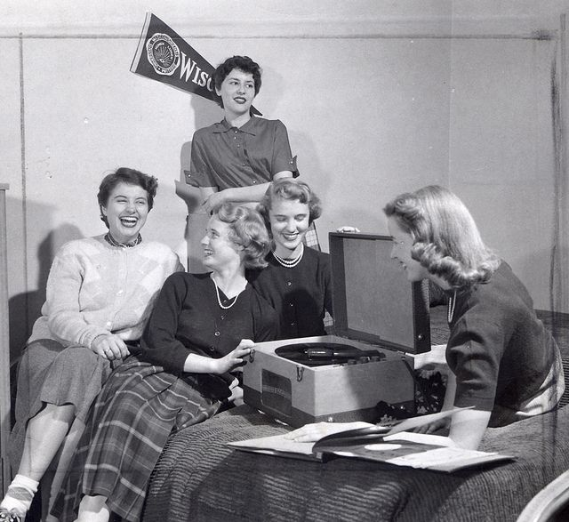 5 women listen to records in Liz Waters dorm in 1930. For more information about this image, contact the University of Wisconsin Madison Archives at uwarchiv@library.wisc.edu.