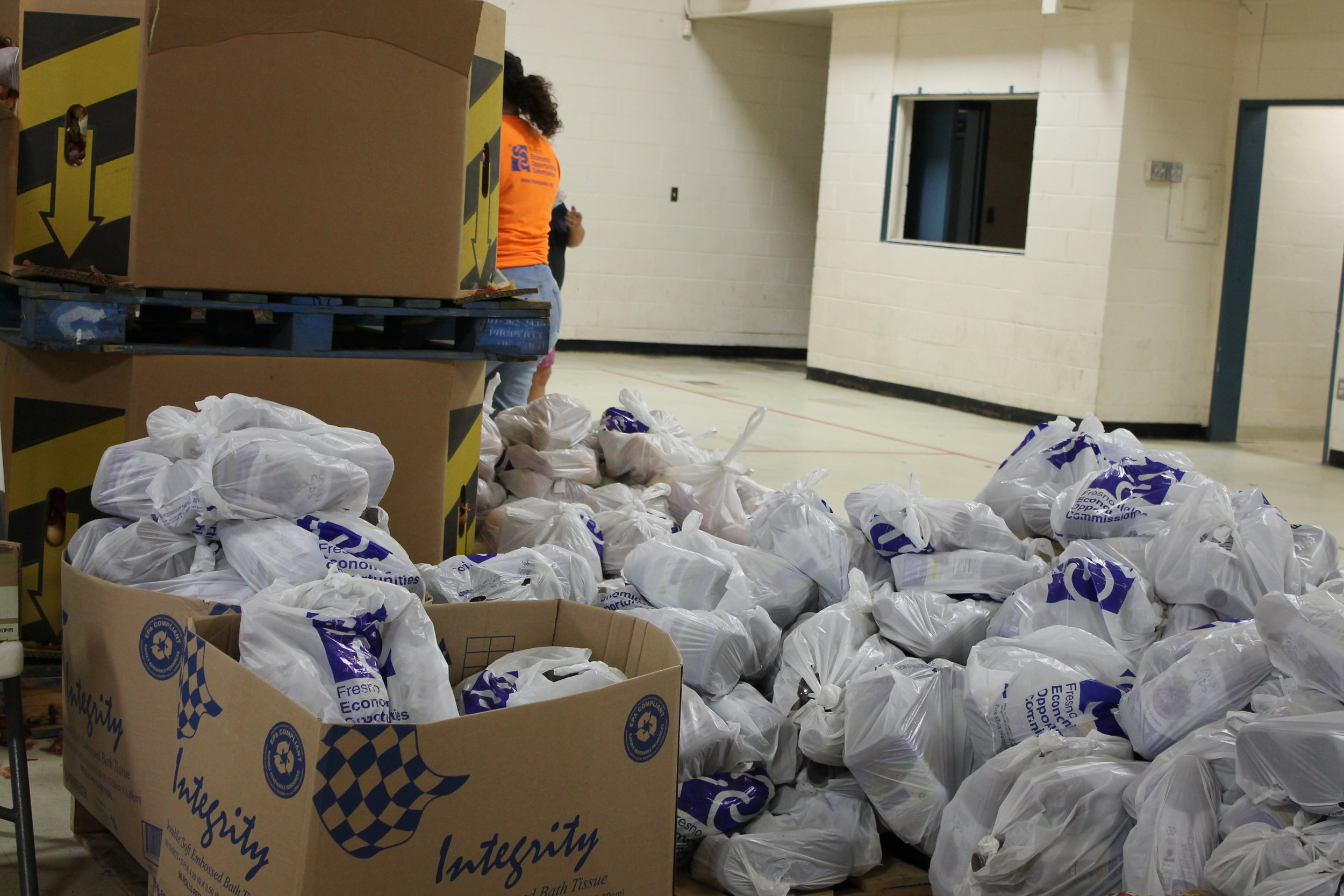 Huron, CA: Bags of food items are distributed to hundreds of farmworker families by the Fresno Economic Opportunities Commission in the community of Huron, CA located in one of the most agriculturally productive regions of California