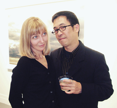 A photograph of Debra Klomp Ching and Darren Ching in Photograph magazine.
