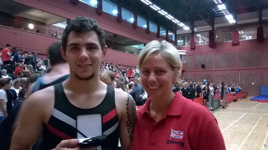 Silver medalist James with his DMT coach Kylie Walker