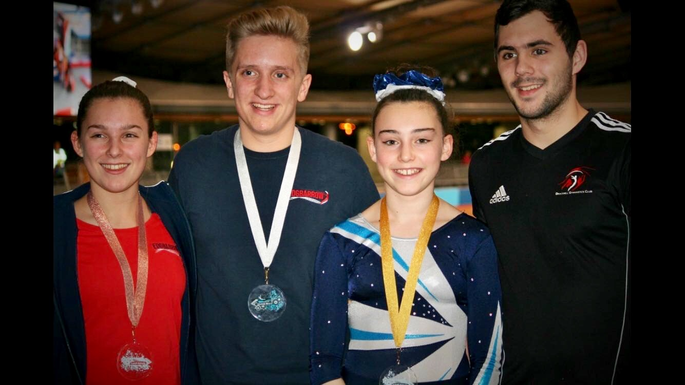 DMT gymnasts with their coach (right) James Langley from Bracknell Gymnastics Club