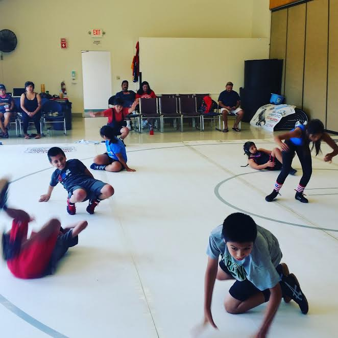 Just like gymnasts, wrestlers learn tumbling so they can fall without getting hurt and roll, and bounce back to their feet using technique.