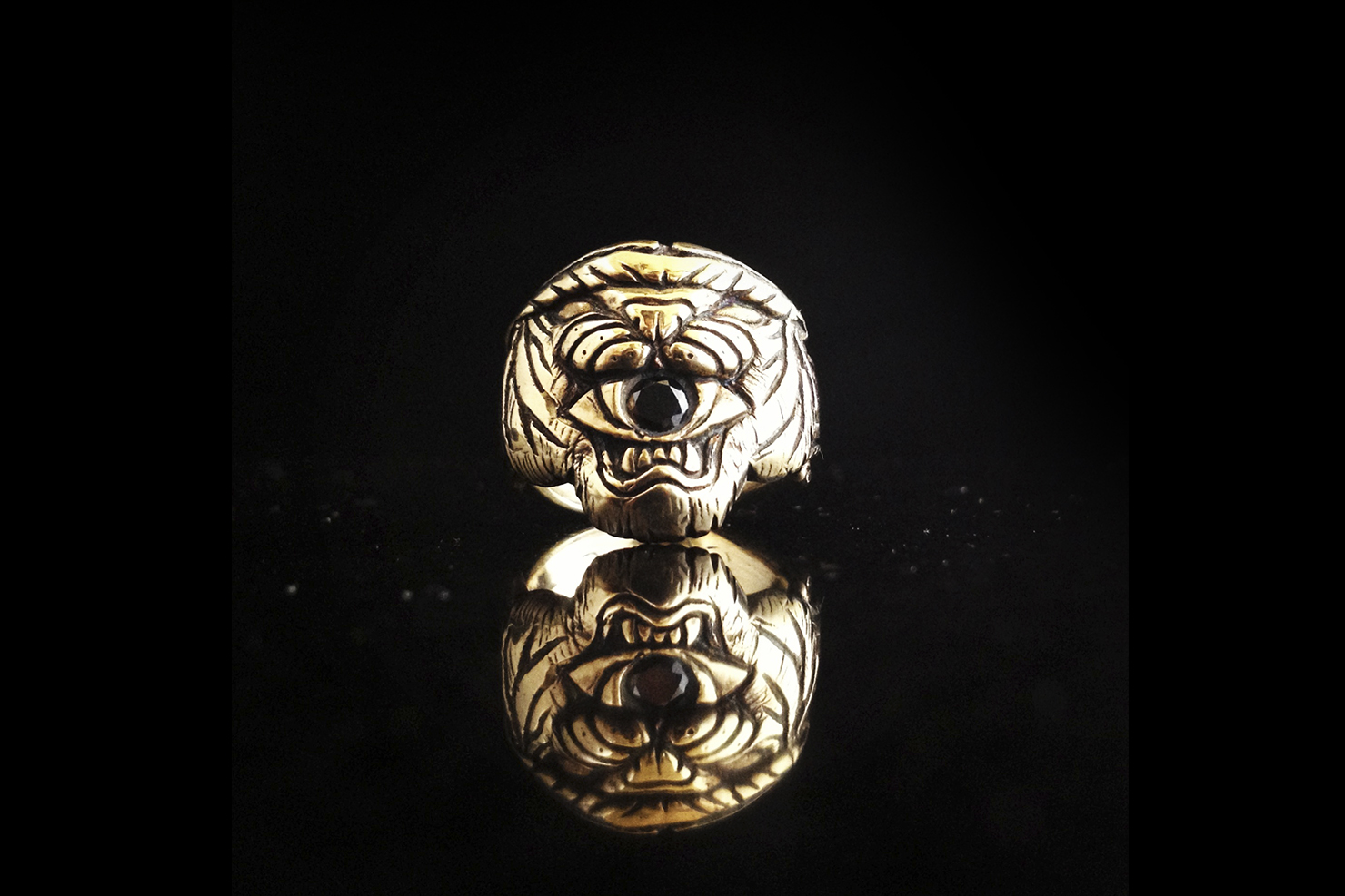 tiger eating eye ring.jpg