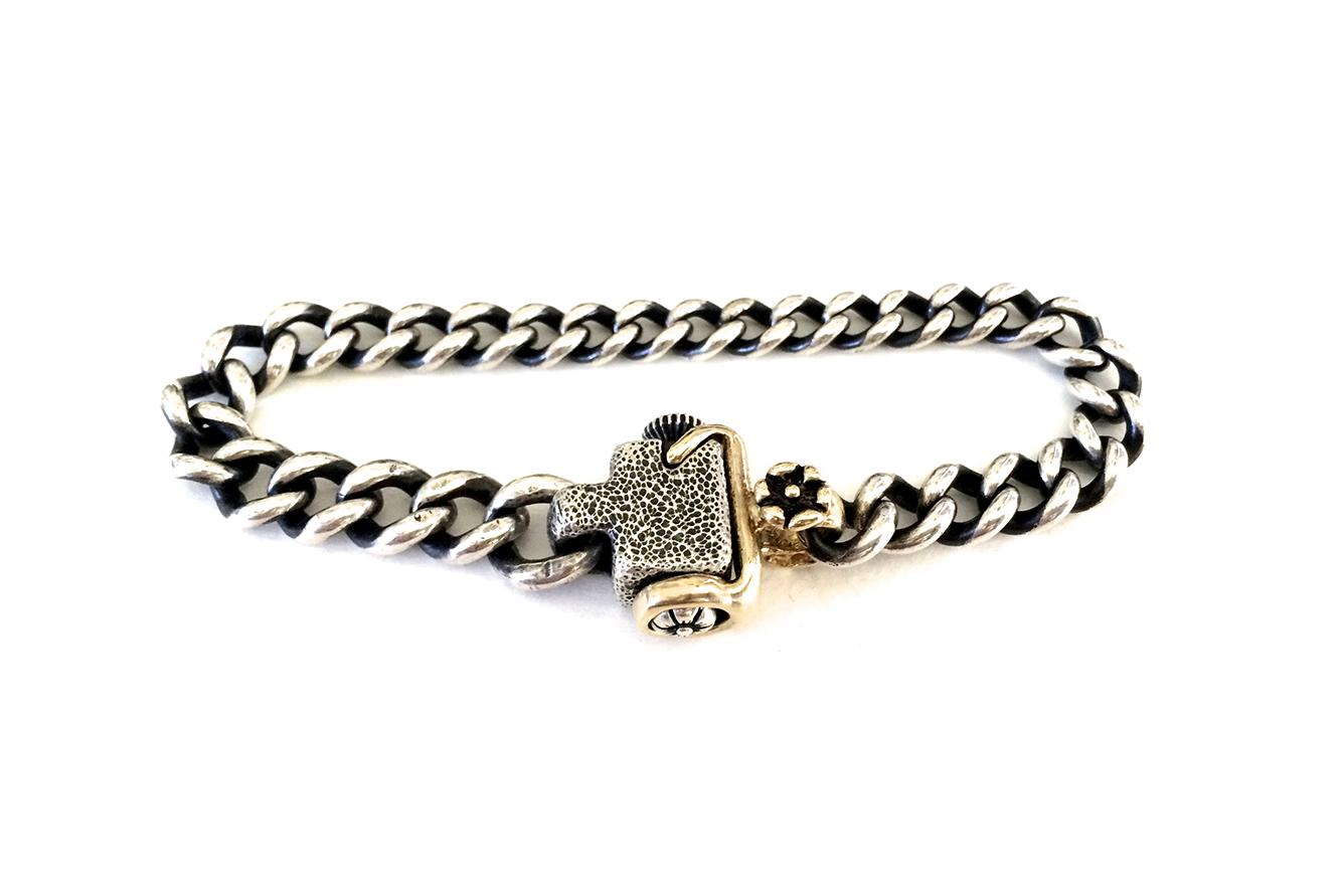 silver bracelet w gold clasp.jpg