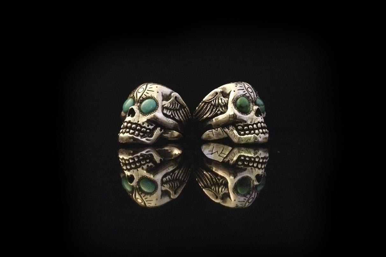 turquoise eyes skull rings.jpg