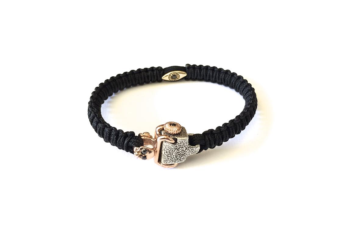 blk woven bracelet w gold & diamond clasp.jpg
