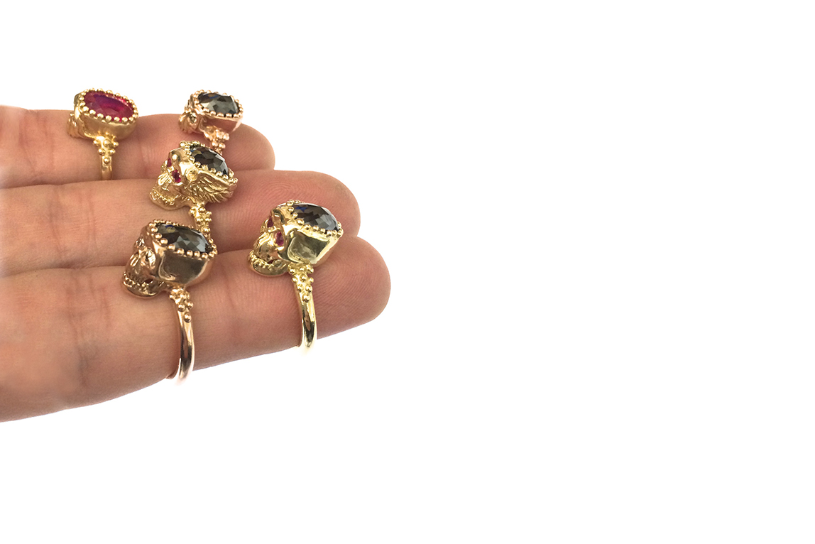 skull rings on three fingers 2.jpg