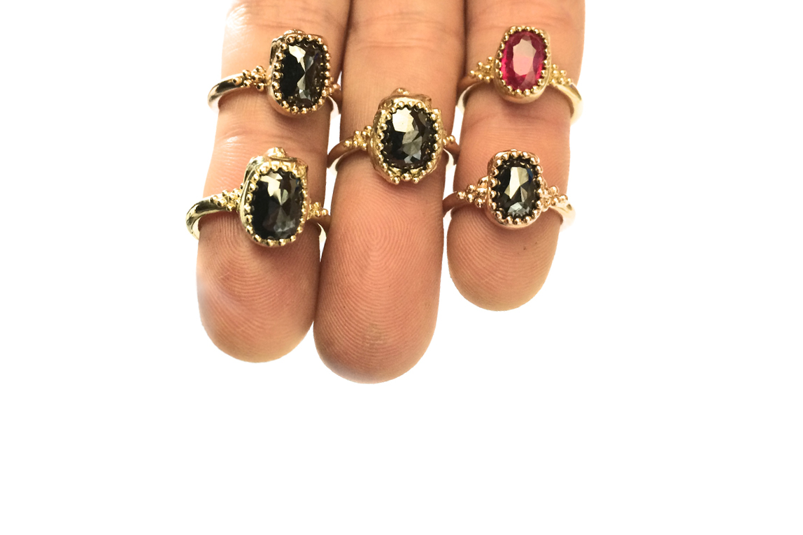 skull rings on three fingers.jpg
