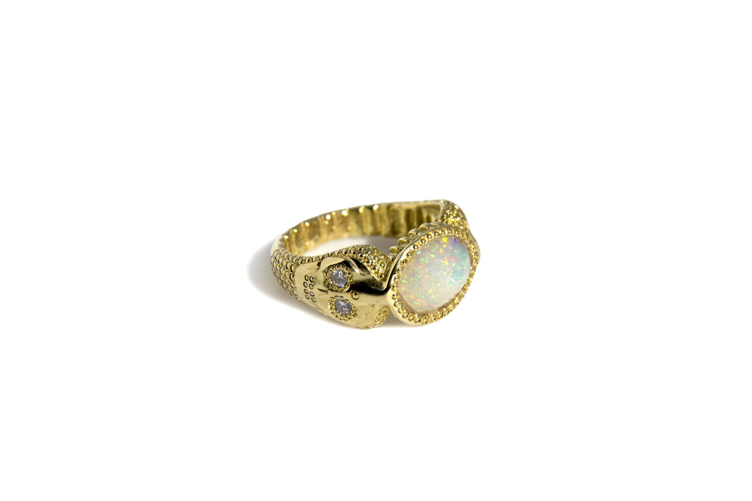 side skull & opal gold ring.jpg