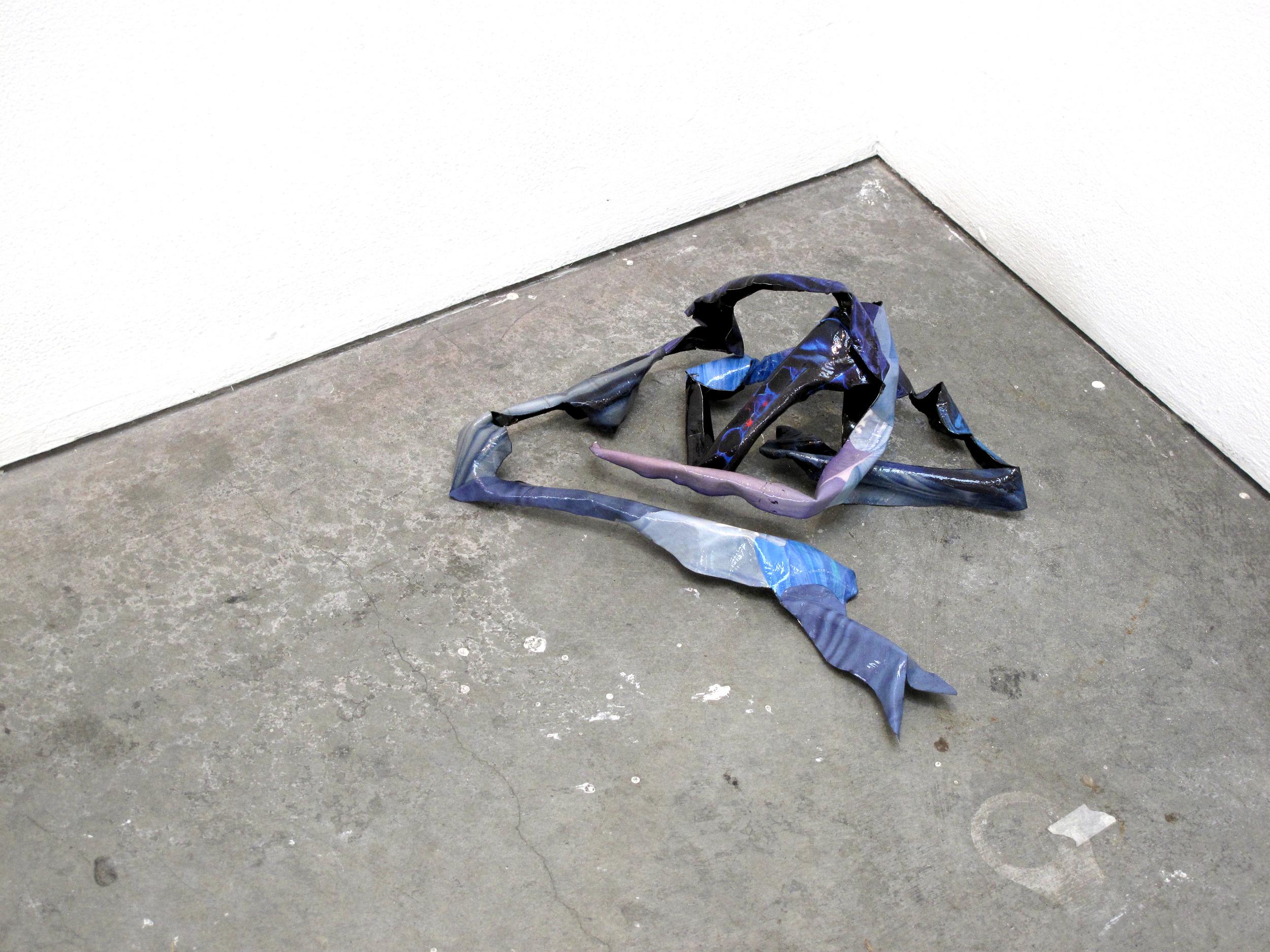 "Phantom Limb(guts),  2015, Found images, aluminum, Approx.14 X 5 X 8"""