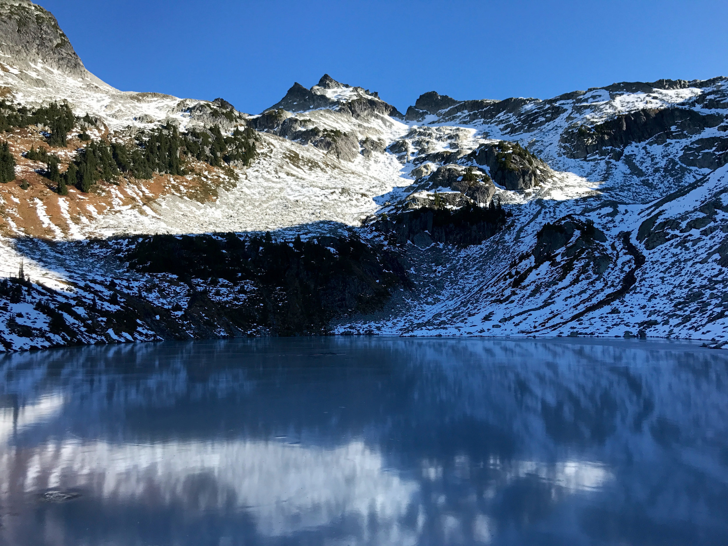 Looking up at the peak across a frozen lake. This was a couple of hours into the hike.