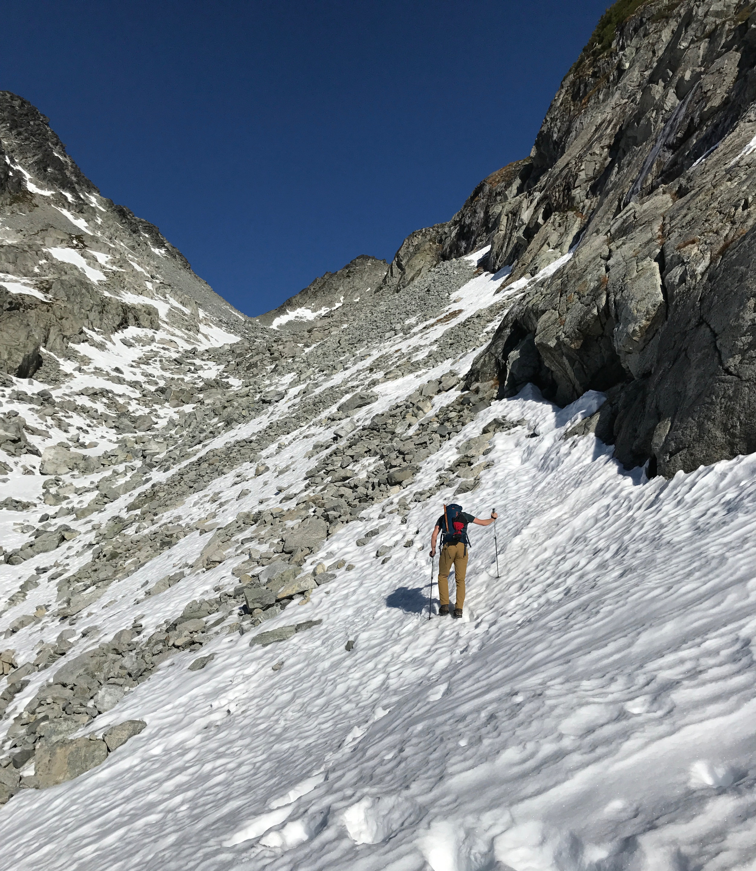 Ty leading the way across frozen snow - we both had two trekking poles for most of the trip, but as things got steeper we switched to mountaineering axes.