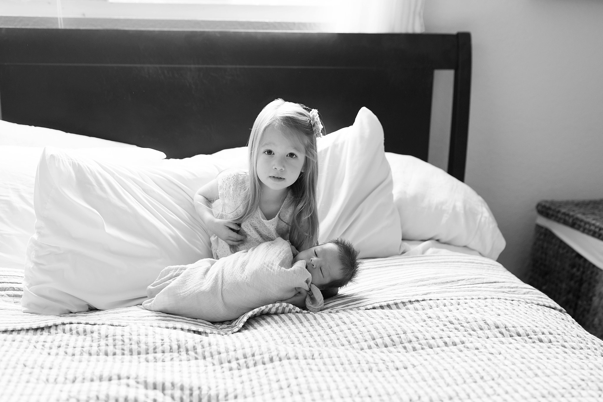 The first time she held her baby brother.