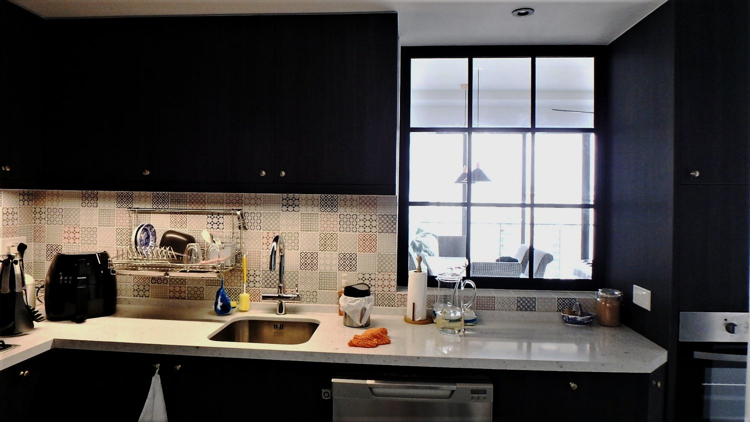 A large window allows more natural lighting into the kitchen while enhancing the transitional colonial look. Quartz counter top for superior durability.