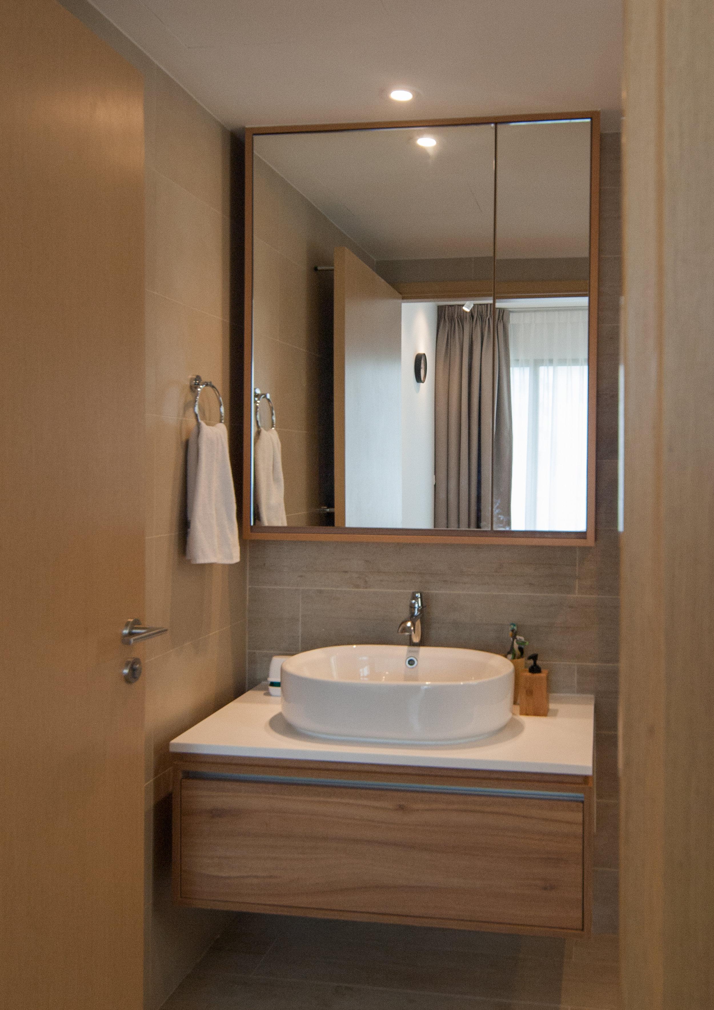 Mirror cabinet in the bathroom.