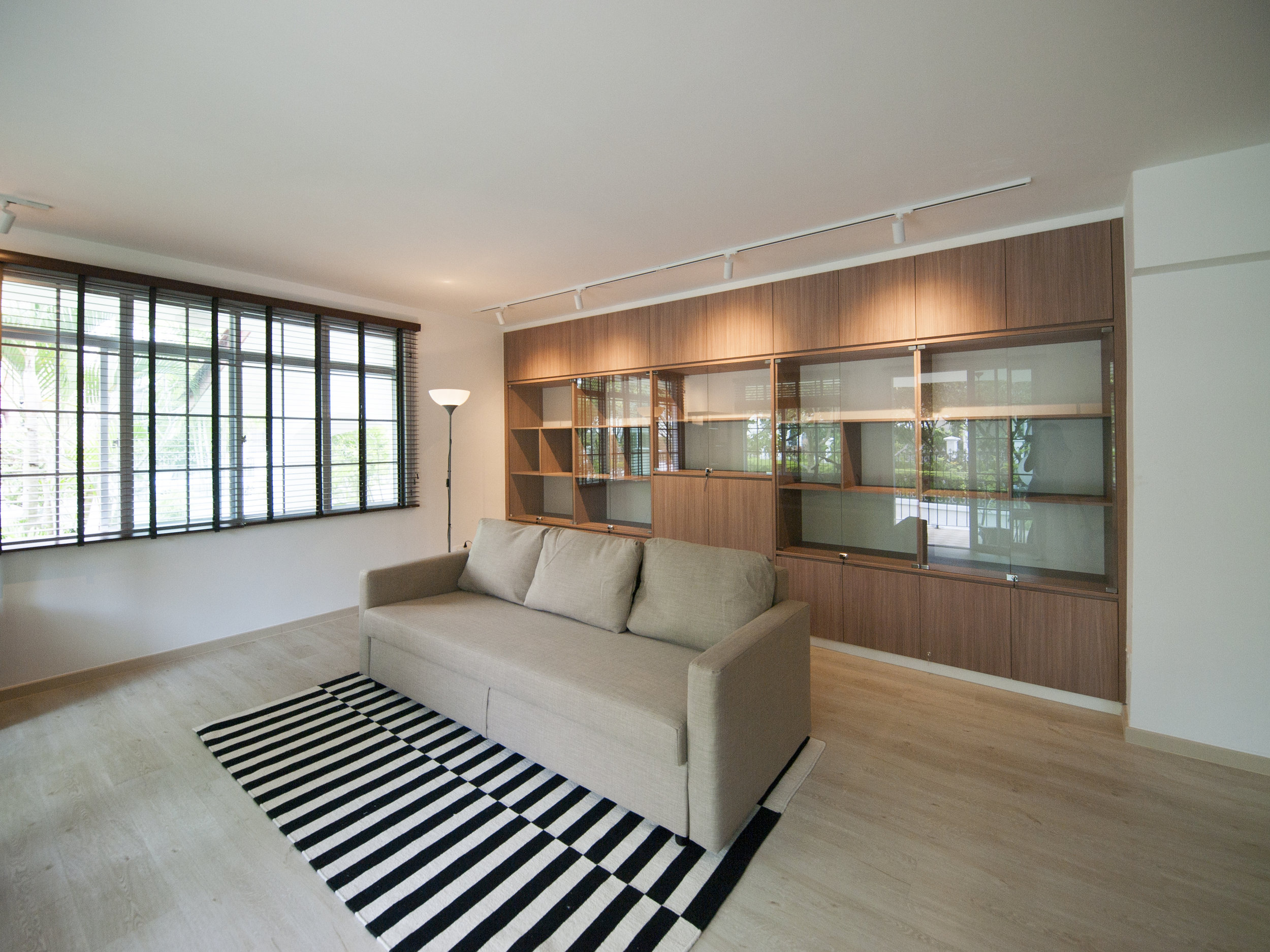 A spacious family lounge with ample space for their prized collection.