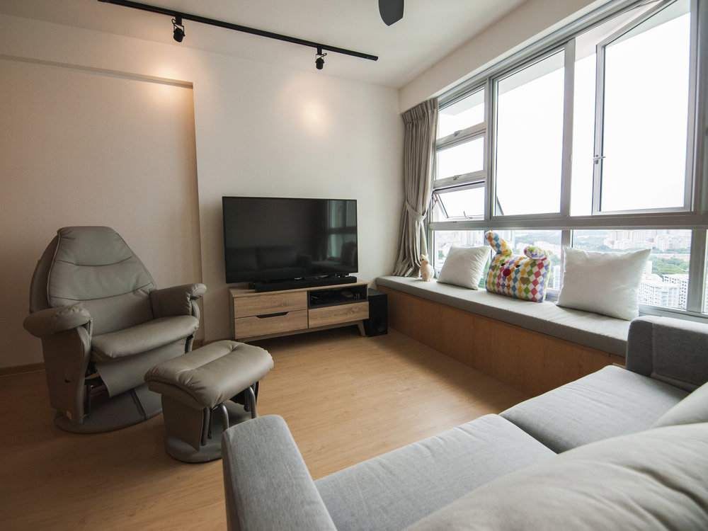 Cosy living space with ample seating and storage.
