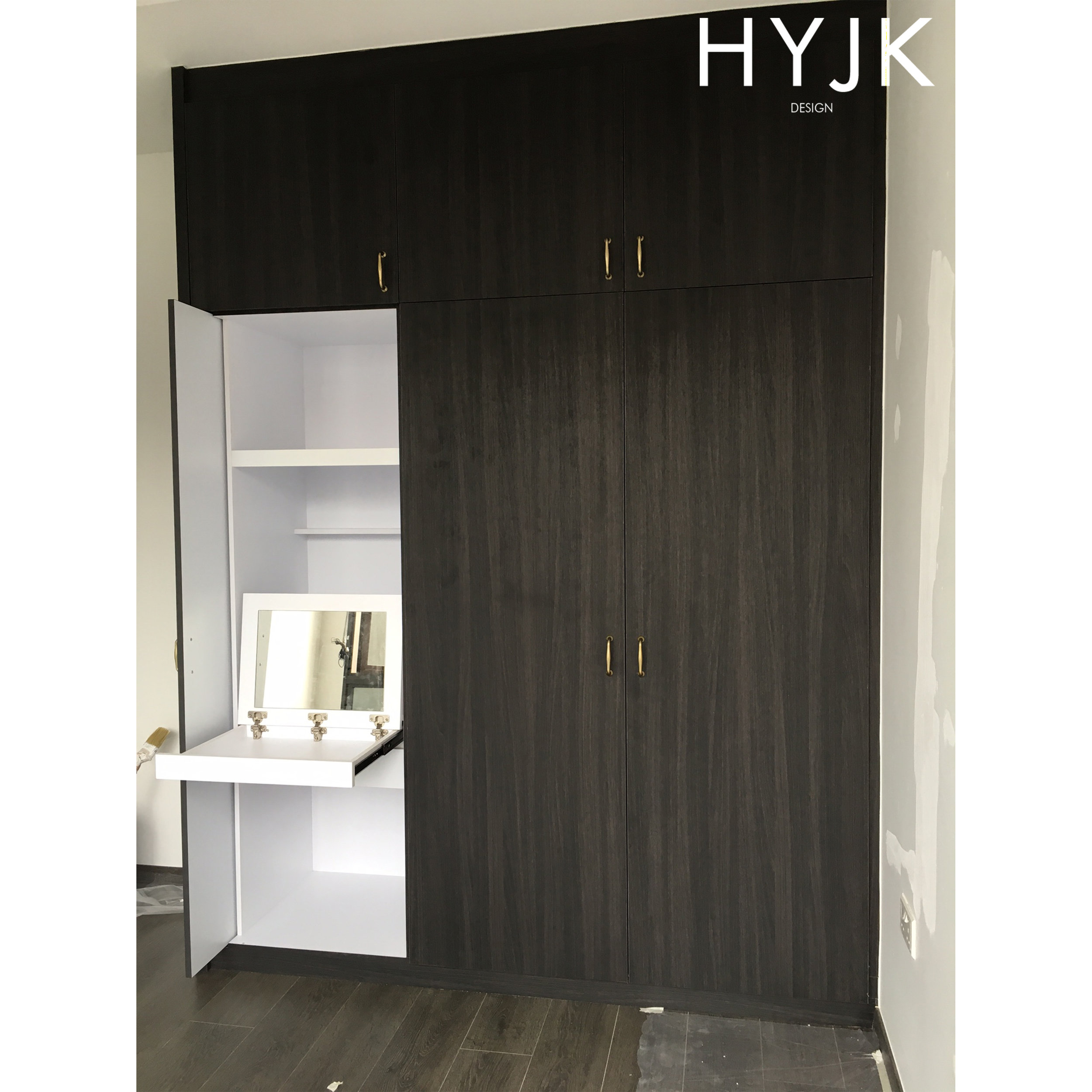 Built-in dresser with retractable wardrobe door featuring a pull-out table top fitted with a mirror.