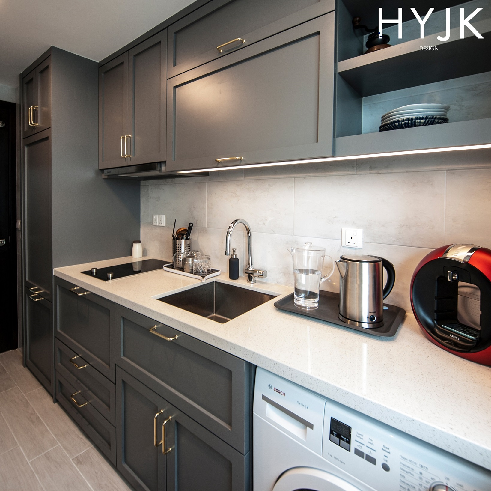 This small transitional kitchen packs a concealed refrigerator, washing machine and microwave!