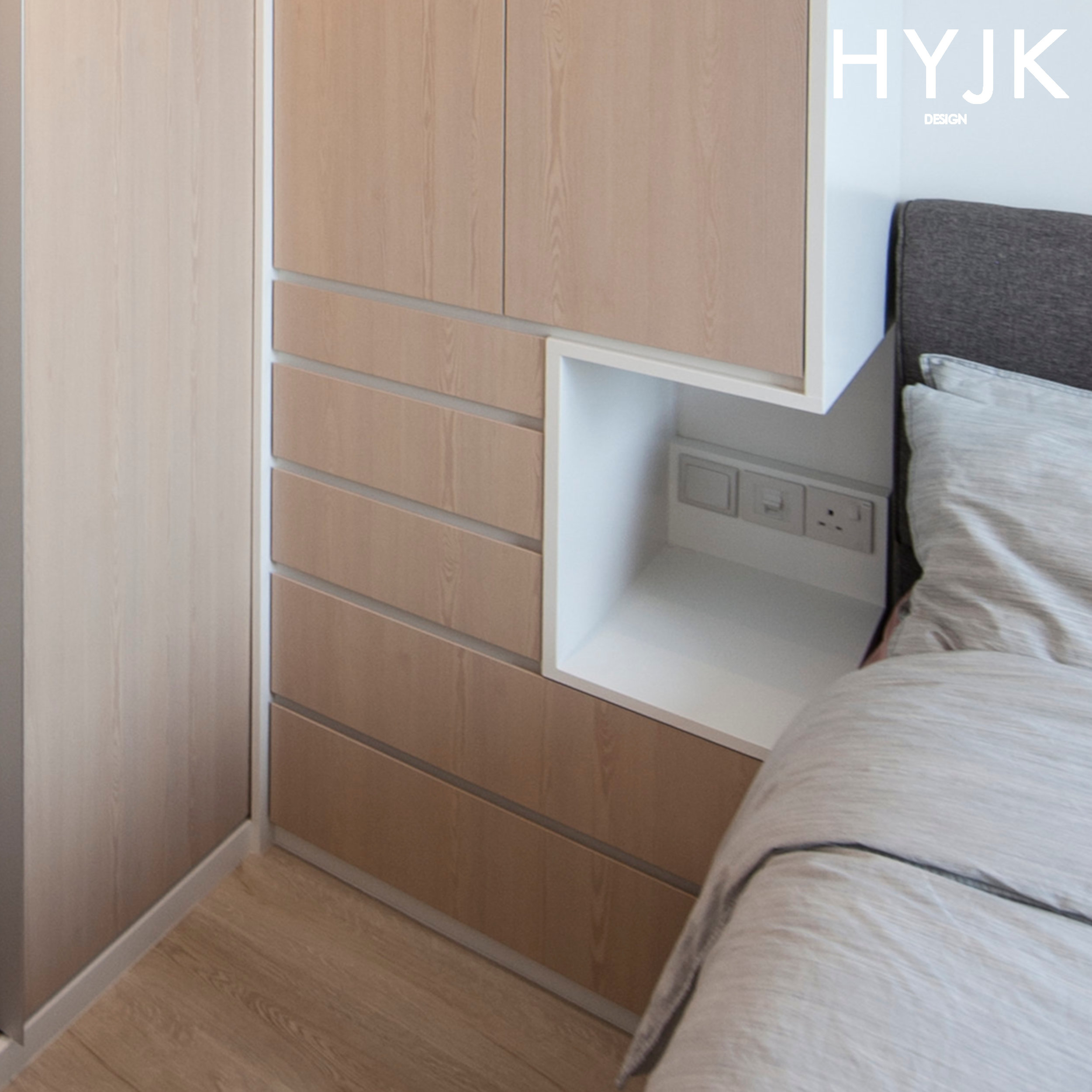 This wardrobe was designed to have a built-in bedside table. Knowing that there was insufficient space to install a stand-alone bedside table, our designers built a tiny nook into the wardrobe with plugs and light switches! (Project Chill Culture)
