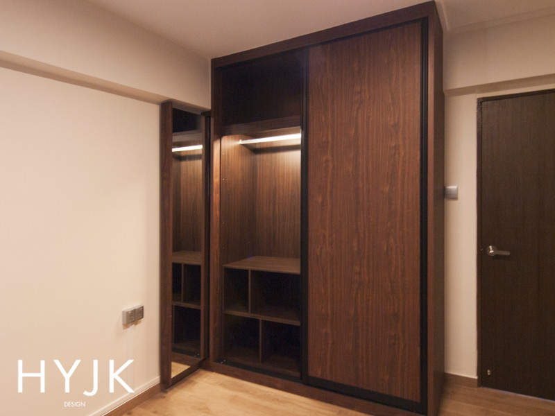 Modular shelves in a wardrobe that can be flipped on its side to make way for long dresses. (Project Invigoration)